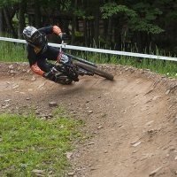 A rider hugs the turn on Snowshoe Mountain
