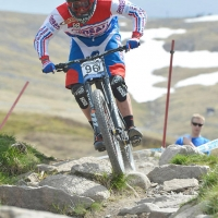 Logan Binggeli rides along the course in Great Britain