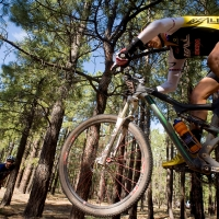 Evan Plews catches air on the Burma trail