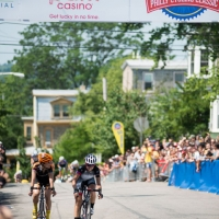 Two women riding through the finish line at the racethe-2013-Parx-Casino-Philly-Cycling-Classic