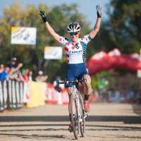 Katie Compton celebrates one of her victories