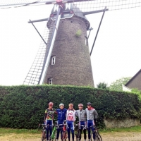 Geoffrey Curran, Justin Oien, Logan Owen, William Barta and Miguel Bryon near a windmill