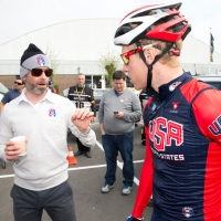 Coach Mike Sayers gives Tanner Putt some pre-race advice