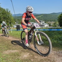 Ellen Noble pulls away from other riders on a climb at the 2014 UCI MTB World Cup in Windham, N.Y.