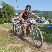 Emily Shields leads Britt Van Den Boogert of the Netherlands up a climb at the 2014 UCI MTB World Cup in Windham, N.Y.