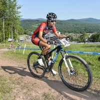 Kaylee Blevins nears the top of a climb at the 2014 UCI MTB World Cup in Windham, N.Y.