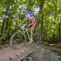 Keegan Swenson takes on a technical section at the 2014 UCI MTB World Cup in Windham, N.Y.
