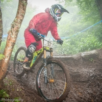 Alison Zimmer trecks through the mud toward the Beech Mountain win.