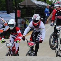 Corben Shrrah leads the pack into turn one as he qualifies for Saturday