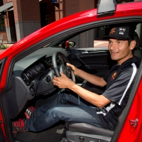 Freddie Rodriguez checks out the new Volkswagen GTI that will be awarded to the road race winners