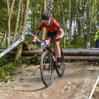 Kate Courtney competes at the UCI Mountain Bike World Cup #4.