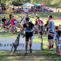 September 2014 winner - A rider is encouraged by his young son at the Charm City Cross.