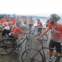 August 2014 winner - Riders dip their tires in the Pacific ocean after riding from Virginia to California to raise money for Multiple Sclerosis research
