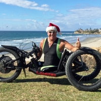 December 2014 winner - Fred Libel gets a new all-terrain mountain hand cycle just in time for some holiday riding at the beach!