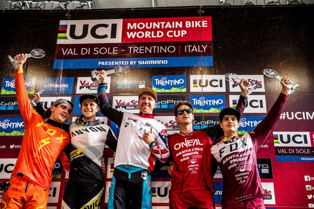 Aaron Gwin celebrates his fifth World Cup title