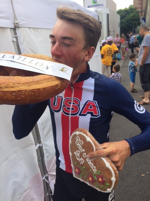 Brandon McNulty basks in the prizes after his third place finish at the 2017 Tour de Alsace