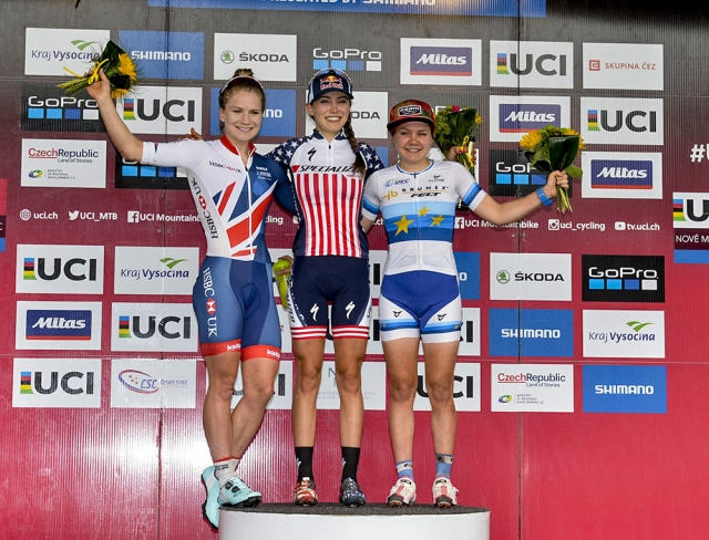 Kate Courtney on the top step of the podium after the U23 race at the UCI World Cup in Nove Mesto